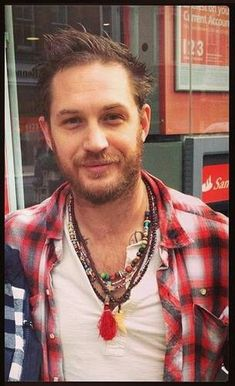 I  love this picture because it does not look staged or posed. Just adorable dude on the street vibe! Granted, its Tom Hardy, but looking like an average dude! <3