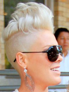 Funky Blonde Haircut with Shaven Sides