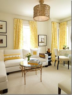 Sarah Richardson used a cream sectional with dark feet and tailored lines in one of her room designs