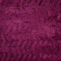 This is a synthetic blend crushed velvet in wine with a cotton/poly backing. Very soft, great for Upholstery.