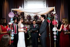I really love the way our Chuppah turned out.  I still have the flower garland hanging in my office. (another view: http://www.flickr.com/photos/nhanusek/4135936081/in/set-72157622881422124 )