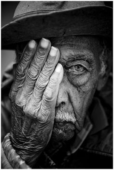 Abilio - black and white by Filip Meutermans. Oldie, man, male, hand, wrinckles, aged, old, hat, portrait, face, photograph, photo b/w.