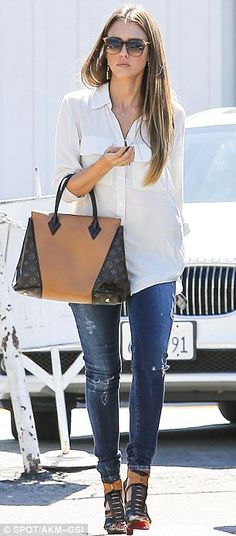 Conquered her body issues: Jessica Alba looked pretty confident on Tuesday as headed to a meeting in Los Angeles looked gorgeous in torn skinny jeans, white blouse and gladiator heels