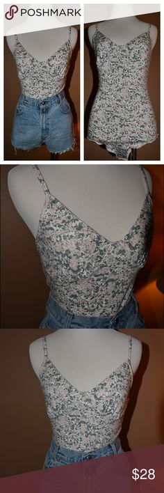 "NWOT Floral Bodysuit by MINKPINK, Size Small Floral bodysuit by MINKPINK which has never been worn. Size small. Would be perfect paired with a pair of high-waisted shorts and a kimono. 27.5"" length , 94% cotton, 6% spandex MINKPINK Tops"