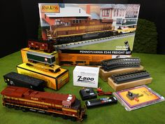 See Them All 2015 MTH RailKing ES44 Freight Sets http://mthtrains.com/railking/spotlight/09_2015/k Now arriving at your MTH Dealer the Pennsylvania - ES44AC Diesel Ready To Run O Gauge Freight Set 30-4234-1 with Proto-Sound 3.0 and a MSRP of $449.95. For more details about this Pennsylvania Freight Set check out the link above to see it and all the other 2015 Ready-To-Run RailKing O Gauge ES44AC Freight Sets and use the Find It Locally tab under the website item page to locate ES44 Freight…