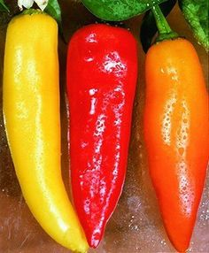 Grow Hot Hungarian Banana Peppers. These are abundant producers and have huge flavor.