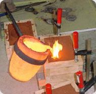 In a foundry, molten metal is poured into molds.