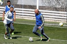 Karim Benzema watches the ball as he was joined in training by Real Madrid boss Zinedine Zidane (R)