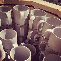 """a whole bunch of """"city mugs"""" going into the bisque kiln!"""