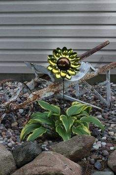 This sunflower spoon flower is welded together with sixteen spoons. Spoon handles are used as the leaves of the flower. Coated with a metallic automotive paint and clear coat to prevent rust. Makes for a perfect gift and looks beautiful in the garden! All flower stems are 24 inches tall. For more information visit: dewallbros.com