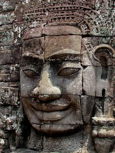 Hundreds of playful faces at The Bayon in Angkor Thom, Siem Reap, Cambodia