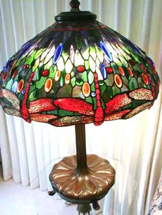 Louis Comfort Tiffany, Tiffany Studios Lamps, & L C Tiffany Favrile Glass History & Reference Information @ Collectics!