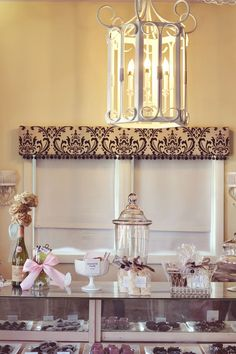 Love the cornice board upholstered and finished with pom trim---would be so cute in a fun fabric for Ava's room