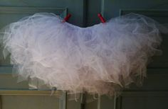 Here's a tutorial for those of you don't want to wrestle tulle, invisible thread, and a sewing machine in order to create the tutu of your little girl's dreams.