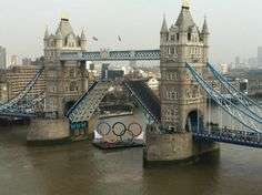 Olympic Rings sailing down the River Thames under Tower Bridge to be later suspended from the top of the bridge The Places Youll Go, Places Ive Been, Down The River, River Thames, Places Of Interest, Summer Olympics, Adventure Is Out There, Tower Bridge, Great Photos