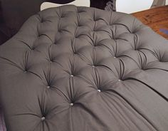Tufting a Headboard the EASY Way | Next, flip the headboard over, pull the fabric taught and