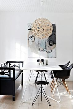 A Dreamy Nordic Home. Wooden bench by Oliver Furniture. Lamp David Trubridge. Chairs Eames.