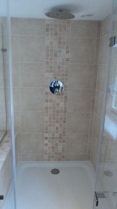 Mosaic tiles make a great feature strip in a shower. Shown here: Nova Roma Travertine Tumbled mosaics