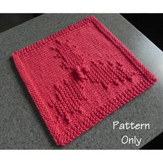 Holly & Berries knit dishcloth pattern by Aunt Susan's Closet.