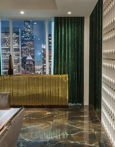 """The Buffet Other than a roaring fire, the only moment of coziness comes courtesy of the green velvet curtains that frame those million-dollar Space Needle views. (We thought you said you didn't """"do romance,"""" Mr. Grey!) Paired with a textural gold console table, the vibe is undeniably luxe. The Buffet"""