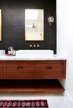 Black wall tile in a master bathroom | Orbit Sconce by Schoolhouse Electric