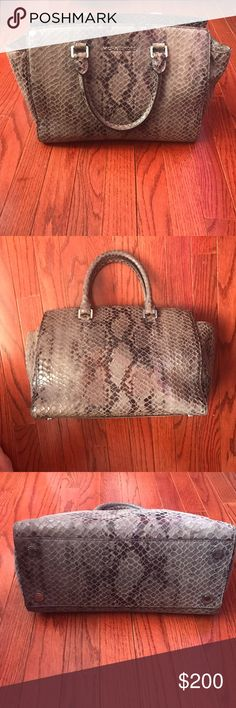 Michael Kors Grey Jet Set Handbag Super cute in like new condition Michael Kors Jet set Selma grey snake skin like purse. Silver detailing. Super cute on! Grey snakeskin or leopard print. No wear on the inside or outside of the bag. Worn maybe once. Received as a gift! Medium size!  9inches   X 17 inches Michael Kors Bags