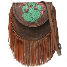 """Who ever ends up with this fun Prickly Pair Bag is one lucky lady! Featuring an old saddle bag aesthetic that is brought to life by a stunning tooled and painted prickly pair cactus motif and finished off with super soft leather fringe. This bag is sure to turn heads and create serious accessory envy! Dimensions measure10"""" W x 9"""" H x 5"""" D with an adjustable strap that can go as long as 55""""."""