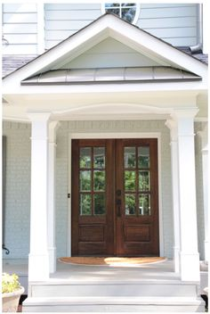very pretty front doors probably not enough privacy though took out door and sidelights and replaced with wood french doors