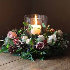 scented cream piaget, caffe latte and pavlova roses arranged with English ivy trails, berries, birch twigs, rosemary, astrantia and finished with fir cones. Once the flowers have faded the herbs and foliage will continue through the festive season. To complete the look select the large hurricane lamp and candle from …