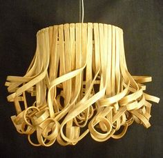 You won't be able to resist admiring these elegant curls of rattan that hang nonchalantly on this pendant.