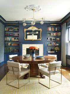 Interior design by Danielle I. Monteverdi. Milieu Home Goods. Home in Larchmont NY. Blue damask wallpaper. French cava fireplace. Milo Baughman chairs. Blue walls.