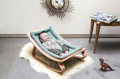 The beautiful wooden LEVO rocker is a modern baby bouncer you'll keep for generations.