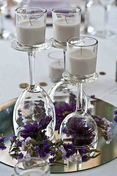 Upside down wine glasses and candles and flowers