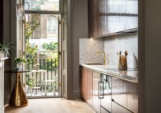 Dark walnut doors with brass inlay and marble worktop and backsplash to this petit kitchen for a pied de terre in London. French doors lead to a balcony for al fresco dining or morning coffees Georgian Townhouse, Georgian Homes, Architects London, Walnut Doors, Timber Structure, Luxury Flooring, Concrete Steps, Residential Architect, Listed Building