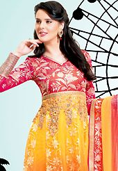 The glamorous silhouette to meet your most dire fashion needs. The dazzling dark pink, yellow and shaded orange net churidar suit have amazing embroidery patch work is done with resham, zari, sequins and lace work. The entire ensemble makes an excellent wear. Matching dark pink santoon churidar and shaded dupatta is available with this suit. Slight Color variations are possible due to differing screen and photograph resolutions.