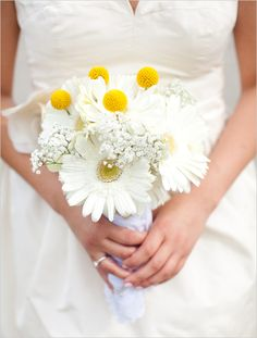 gerber daisy bridal boquet- get rid of those pompoms and add a bit of blue accent