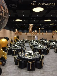 Table numbers with a difference - in the form of golden balloons, hovering over each . 50th Birthday Party Decorations, 70th Birthday Parties, Balloon Decorations Party, 50th Party, Birthday Stuff, Black And Gold Party Decorations, Black And Gold Centerpieces, Masquerade Ball Party, Gatsby Themed Party