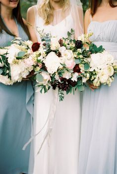 grey & blue bridesmaids dresses with deep red floral accents | image via: style me pretty