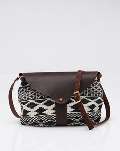 The Taplin handbag from Shelter is made of a woven Aztec inspired print on the outside, with a bright duck cloth highlight inside and welt pocket. Feature stone oil leather from North American hides and all brass hardware with Sam Brown closure. My Bags, Purses And Bags, Fashion Bags, Fashion Accessories, Hippy Chic, Fall Handbags, Cool Style, My Style, Saddle Bags