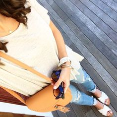 IG @mrscasual <click through to shop this look> Tassel cross body bag. Striped swing tee. Raw hem destroyed skinny jeans. Dolce vita delila two tone sandals.