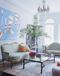 With high ceilings, arched windows, and a striking painting by Caio Fonseca, Sex and the City author Candace Bushnell's Manhattan living room is as stylish and lively as the world portrayed in her books. A Louis XVI sofa purchased from Christie's in the '80s, a 19th-century tufted settee, and Moroccan poufs from John Derian Co. make an eclectic seating arrangement. The room is ready for entertaining with a bar and a mini fridge–stocked with champagne–tucked in a cabinet in a corner.