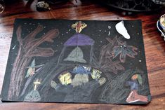 Childhood drawings of worshipping witches and burning crosses.