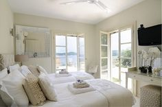 This is a beautiful guest room. love the multiple doors and beautiful accent pieces in this room.