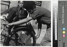 Boys Fixing Bicycle - 1950's   Romul Luchatanere'