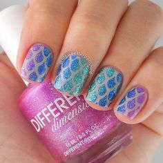 Mesmerizing gradient glitter nail art design in droplet shapes and atop a matte brown nail polish base.
