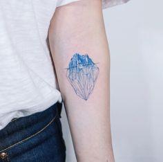Geometric iceberg tattoo by Sol Art
