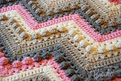 Hugs & Kisses Crochet Blanket - Free Pattern - A brand new granddaughter is arriving soon, so that means a brand new baby blanket in honor of her. This crochet project features a series of cross stitches and bobbles, or X's & O's, so that is how this became the Hugs & Kisses Baby Blanket.