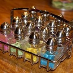 ~~***UP-CYCLED SALT SHAKERS***~~    Salt shakers used to hold decorative colored sugars or glitter....Love this idea...