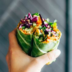 Detox Rainbow Roll-Ups with curry hummus and veggies in a collard leaf, dunked in peanut sauce! most beautiful healthy desk lunch.