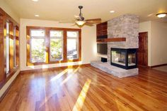 Three sided fireplace and living area in a custom home by G.J. Gardner Homes